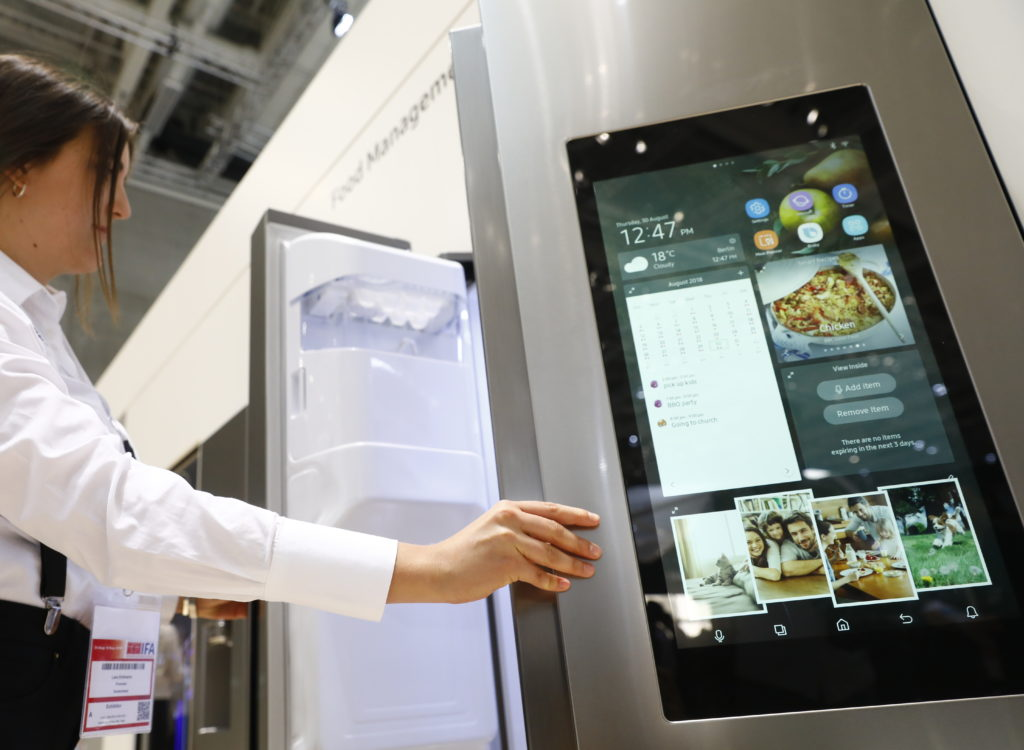 Visitors look at the Samsung Home appliance smart Fridge at the 2018 IFA consumer electronics and home appliances trade fair during the fair's press day on August 30, 2018 in Berlin, Germany. (Photo by Michele Tantussi/Getty Images)